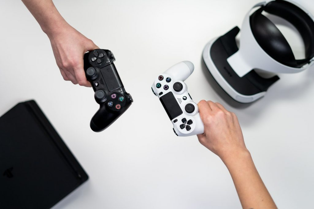two-video-game-controllers